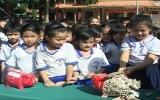 Huyện Dầu Tiếng: Lễ khui heo đất tại các trường học