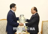 PM promises optimal conditions for Korean investors