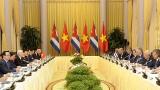 越共中央总书记、国家主席阮富仲与古巴国务委员会主席兼部长会议主席米格尔•马利奥•迪亚斯-卡内尔•贝穆德斯举行会谈