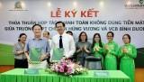 Vietcombank Bình Dương ký kết thỏa thuận hợp tác thanh toán không dùng tiền mặt