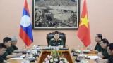 越南国防部长吴春历大将与老挝国防部长占沙蒙•占雅拉大将通电话