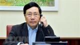 越南政府副总理兼外长范平明与古巴外长通电话
